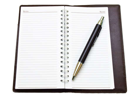 Opened pocket notebook and ballpen on the right Stock Photo - 17529441