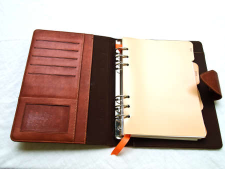 Opened red-brown organizer Stock Photo - 17529471