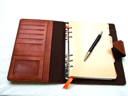 Opened red-brown organizer with a pen Stock Photo - 17529463