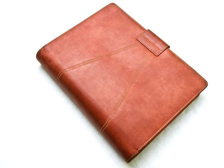 Red brown leather organizer isolated by white Stock Photo - 17529432