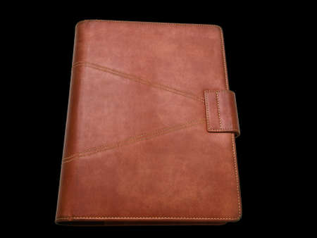 Red brown leather organizer isolated by black photo