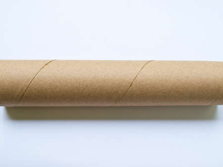 Light brown roll paper isolated on white background photo