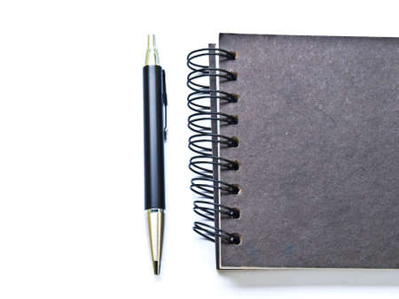 ballpen: Ballpen and a black spiral binding notebook cover on white