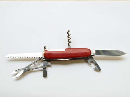 A red Army Knife multi-tool isolated on white background Stock Photo - 17529429