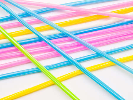 Colorful straws isolated on white back ground photo