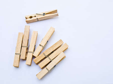 Wooden clothes clips isolated on white back ground Stock Photo