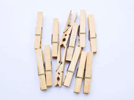 Wooden clothes clips isolated on white back ground photo