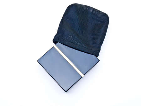 Face powder in a black box and pouch isolated in a  white background