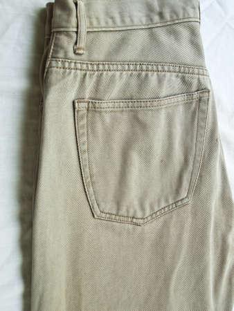 khaki pants: Back pocket on khaki jean pants