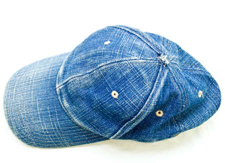 Top view of used blue jean cap isolated on white background photo