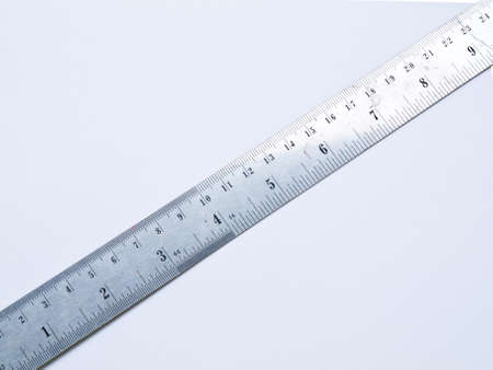 A used stainless steel ruler isolated on white background Stock Photo