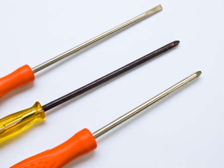Used screwdrivers isolated on a white background photo
