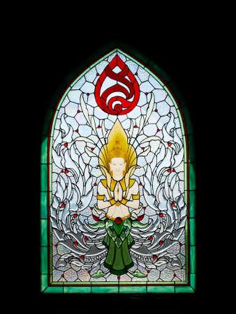 of the holy trinity: Thai angel stain glass in Srinakarinthara Mahasandhikiri Pagoda on Mae Salong hill, Chiang rai, Thailand