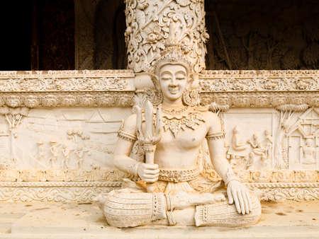 Angel white stucco in city pillar shrine, wat Mingmuaeng  Nan Thailand Stock Photo - 17649070