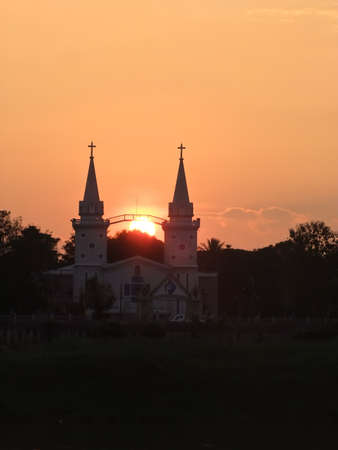Silhouette scenery of Saint Anna Nongsang s Catholic Church from Mekong river, Nakorn Phanom, Thailand photo