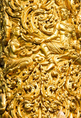 Close up of Golden wax sculpture at Tung Sri Muang park in Ubon Ratchathani province, Thailand photo