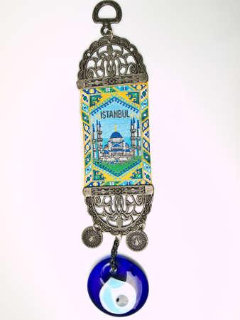 Turkish evil eye trinket isolated on white background photo