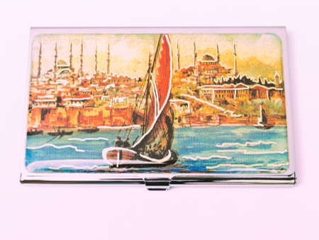 Painting of Istanbul, Bosphorus, Mosque and the ship on the metalic business card cover isolated on white background Stock Photo
