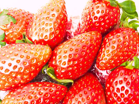 Fresh Strawberry piled in clear plastic box as background photo