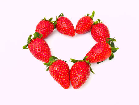 Fresh strawberry line in heart line Isolated on white background photo