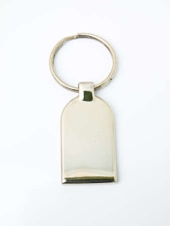 A metalic trinket keychain isolated on white background Stock Photo