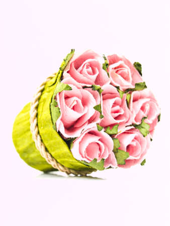 Pink paper roses  bouquet isolated on white background photo
