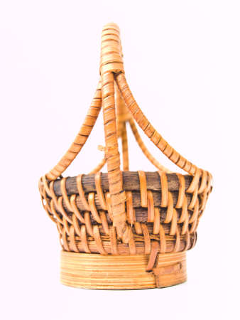 A yellow wicker basket isolated on white background Stock Photo