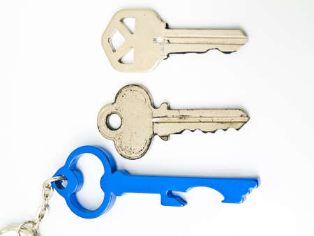 Couple keys and  a blue stainless steel keys keychainisolated on white background