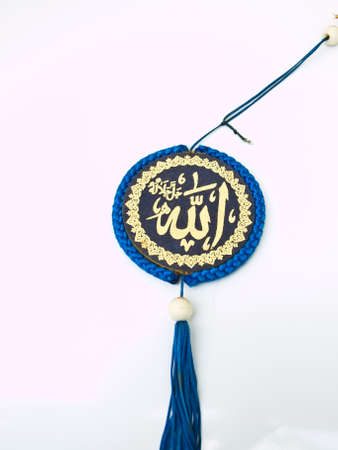 A blue velvet Allah pendent isolated on white background