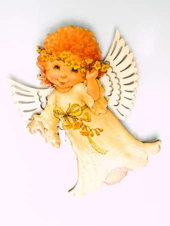 A child angel magnet isolated on white background
