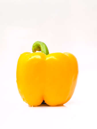 Fresh yellow bell pepper, Capsicum annuum, isolated on white background
