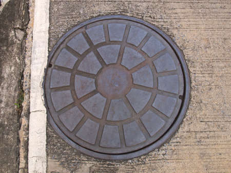 Rusty steel manhole cover
