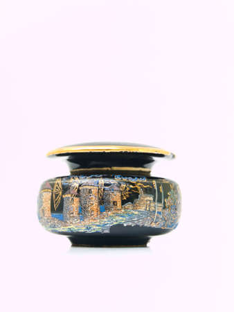 tourist destinations: A black miniature ceramic jar painted by  tourist destinations in Rome, Italy isolated on white background
