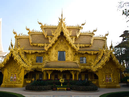 Facade of golden toilet, Wat Rong Khun at Chiang Rai, Thailand photo