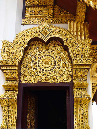 Closeup of golden wooden carving entrance gate, Wat Phrathat chomkitti temple in Chiang rai, Thailand Stock Photo - 17879577