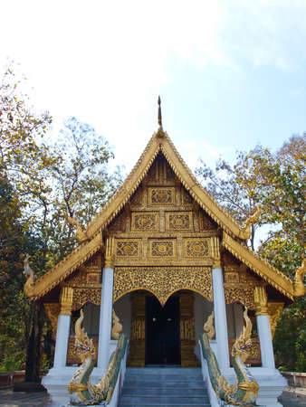 golden wooden carving of Buddhist monastery facade, Wat Phrathat chomkitti temple in Chiang rai, Thailand  photo