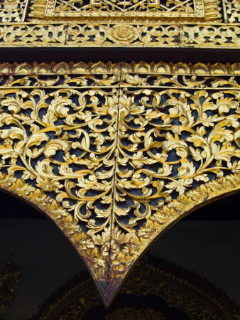 Closeup of golden wooden carving, Wat Phrathat chomkitti temple in Chiang rai, Thailand  photo