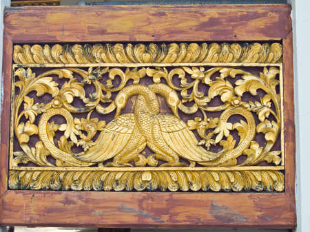 golden wooden carving of peacocks, Wat Phrathat chomkitti temple in Chiang rai, Thailand  photo