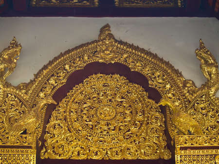 golden wooden carving, Wat Phrathat chomkitti temple in Chiang rai, Thailand  photo
