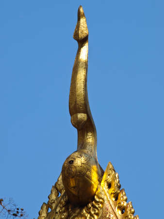 golden wooden carving of gable apex, Wat Phrathat chomkitti temple in Chiang rai, Thailand Stock Photo - 17879693