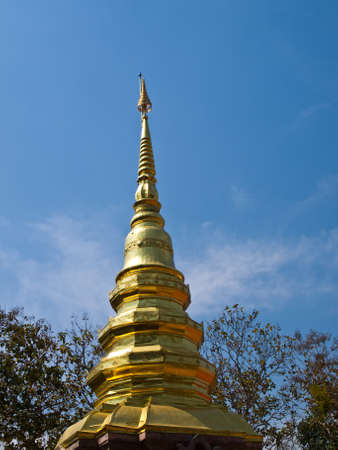 Top of golden pagoda, Wat Phrathat chomkitti temple in Chiang rai, Thailand  photo