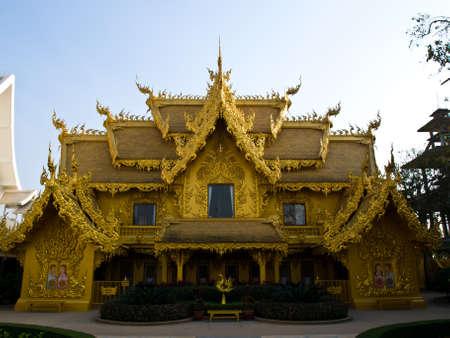 Facade of golden toilet, Wat Rong Khun at Chiang Rai, Thailand photo