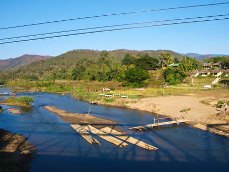 Bamboo rafts in Pai river viewed from Memorial bridge in Pai, Mae hong son, Thailand Stock Photo