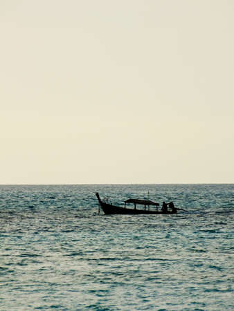 silhouette local fishing boat in Andaman sea, Thailand photo