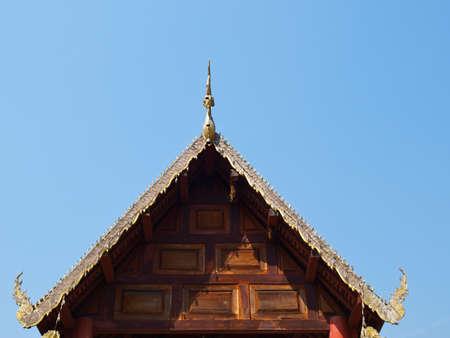 vihara: Traditional wooden gable of Buddhist vihara having bee hive on top in Mae hong Son, Thailand Stock Photo