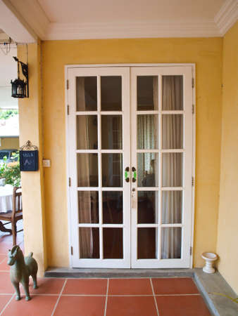 windows and doors: Double patio white french doors with windows on yellow wall