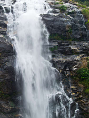 Vachiratar Waterfall in Inthanon Nation Park in Chiang Mai, Thailand photo