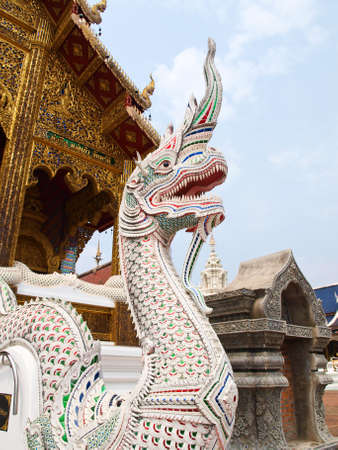 the descendant: A white stucco naga in Wat Baan Den in Chiang Mai, Thailand, traditional lion, guardian, symbol of power and descendant