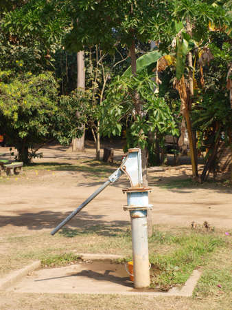 groundwater: Old rusty groundwater pump