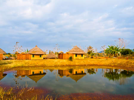thier: Bamboo cottages and and thier reflections in pond in Nakorn Ratchasima,Thailand